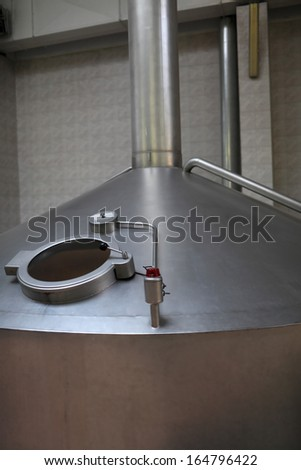 Part of fermentation vat at a brewery - stock photo