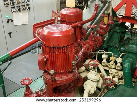 part of fire sprinkler system in the ship engine room - stock photo