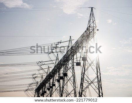 Part of high-voltage substation with sun