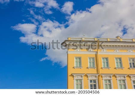 Part of historic building over blue sky - stock photo