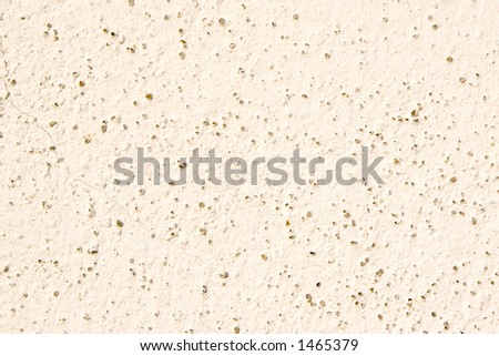 Part of house concrete wall with small crack and sand dot - stock photo