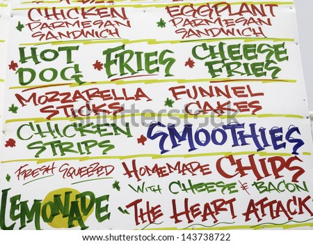 Part of large menu by fast-food booth at a street fair - stock photo