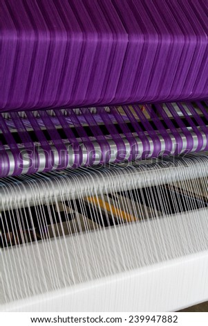 Part of loom with purple thread, beautiful color thread of loom, - stock photo