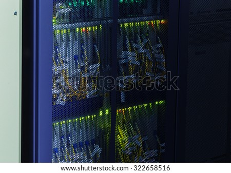 part of mainframes with wires and lighting in data center - stock photo