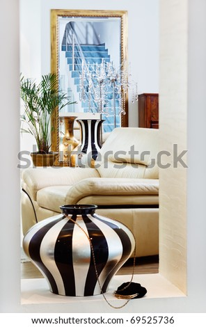 Part of modern art deco style drawing-room interior with striped vase. Shot is made with tilt-and-shift lens and has diagonal focus plane and extremely shallow depth of field - stock photo