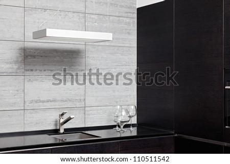 Part of modern kitchen interior with sink - stock photo