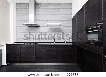 Part of modern minimalism style kitchen interior in monochrome tones - stock photo