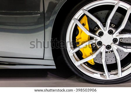 Part of modern new wheel car with disk brake pad - stock photo