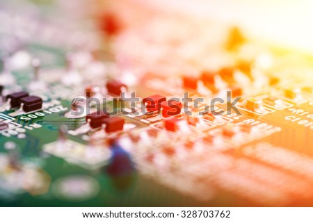 Part of modern printed circuit board with light effects. Extremely shallow DOF. - stock photo