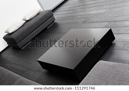 Part of modern sitting room interior in black and white tones - stock photo