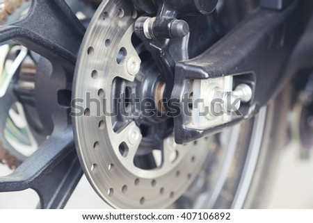 part of motorcycle body, speed motor sport, black big bike - stock photo