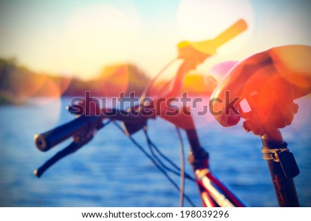 Part of mountain bike on rocky trail - stock photo