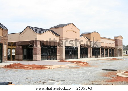 "Part of my ""instant village"" set.  A new suburban shopping center under construction in Atlanta.  Earth tone materials.  Made to resemble a small village main street. - stock photo"