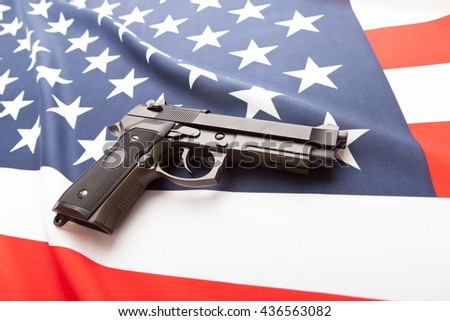 Part of national flag with hand gun over it series - United States - stock photo