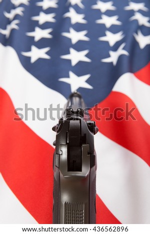 Part of national flags with hand gun over it series- United States of America