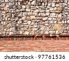 Part of old brick and stone wall / brick wall / fortress - stock photo