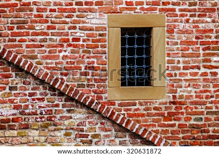 Part of old brick and stone wall, brick wall, with window, from fortress Kalemegdan, Belgrade, Serbia. - stock photo