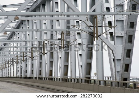 Part of Old Littlebelt Bridge with road and catenary wires - stock photo