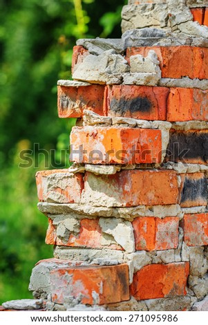 Part of old ruined red brick wall - stock photo