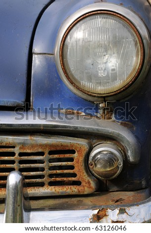 Part of old rusty car made in Russia - stock photo