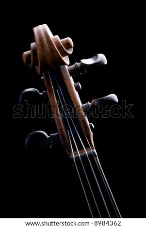 part of old violin close-up isolated on black background - stock photo