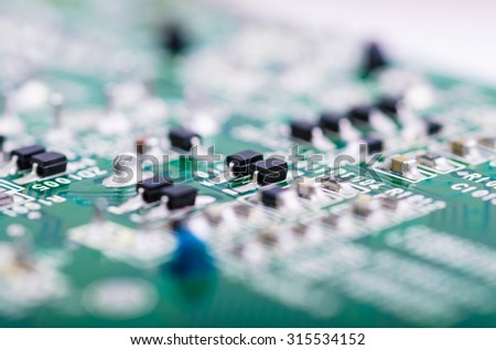 Part of PCB with SMD components. Close up with extremely shallow DOF. - stock photo