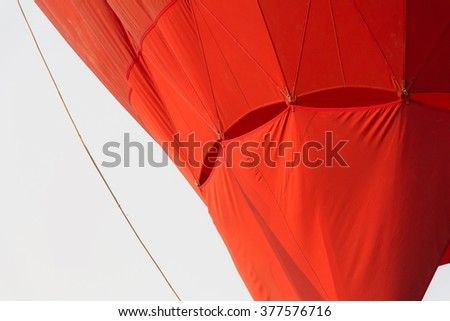 part of red hot air balloon fabric picture - stock photo