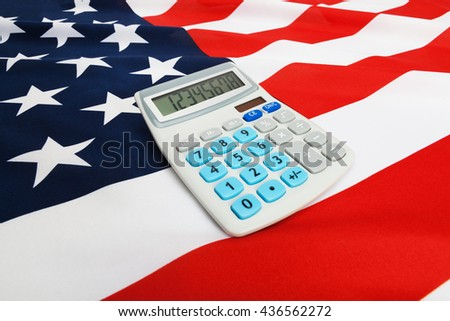 Part of ruffled national flag with calculator over it series - United States