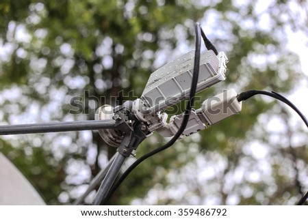 part of satellite dish with bokeh background - stock photo
