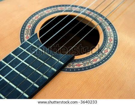 Part of the body of an acoustic guitar - stock photo