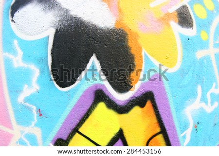 Part of the colorful graffiti on a wall in the park - stock photo