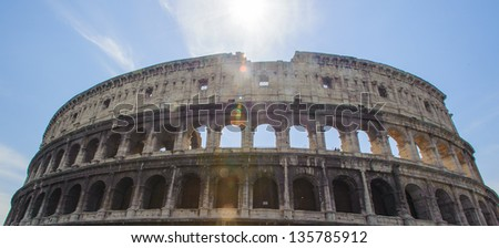 Part of the Colosseum or Coliseum, an elliptical amphitheatre in the centre of the city of Rome, Italy - stock photo