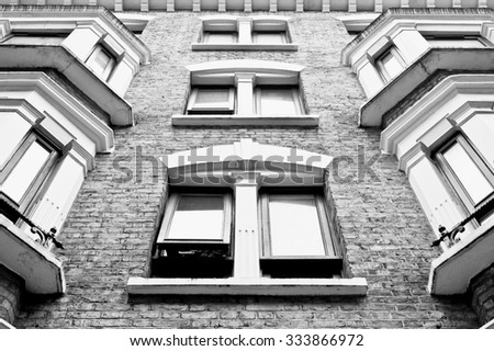 Part of the exterior of a tall residential building in London - stock photo