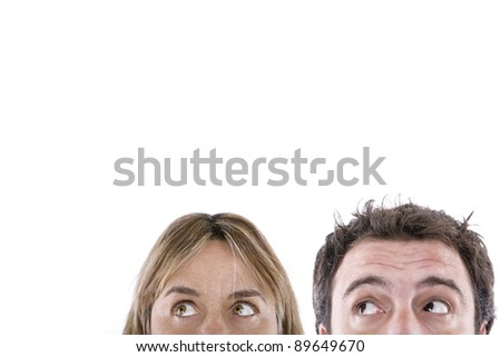 part of the face of a boy and a woman looking up - stock photo
