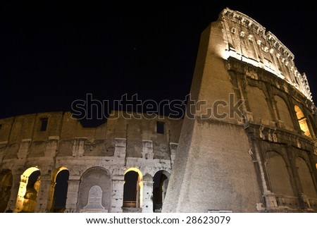 part of the famous coliseum in Rome at night