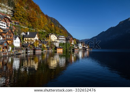 Part of the Hallstatt waterfront at the top of the town during the autumn months. There is space for text. - stock photo