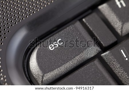 Part of the laptop keyboard with a focus on the esc key.