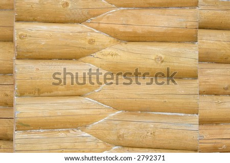 Part of the log house's yellow wall.