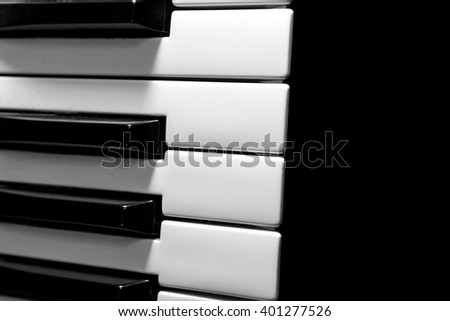Part of the musical keyboard on a black bacground - stock photo