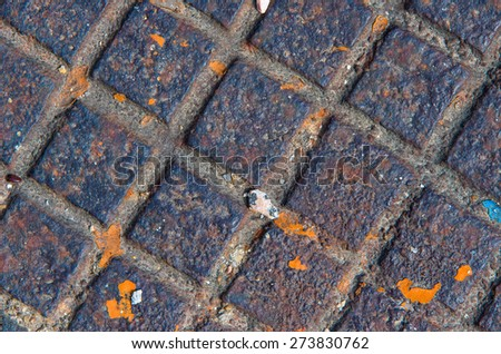 Part of the old textured metal manhole. textural composition - stock photo