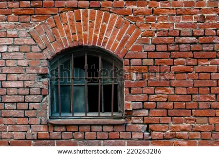 Part of the old wall of red brick with window and arch lattice. From the series window of Saint-Petersburg. - stock photo