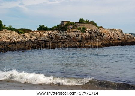 Part of the shoreline, beach and rocky promontory at Fort Williams in Portland, Maine.