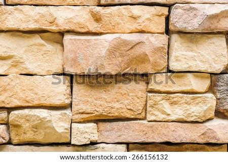 Part of the stone wall. Brown brick wall background texture. - stock photo