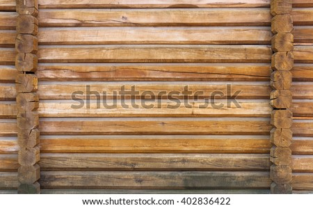 part of the wall made of wooden logs  - stock photo