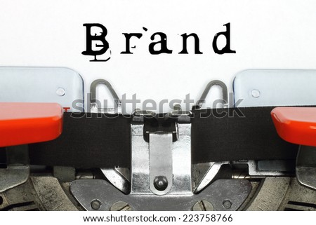 Part of typing machine with typed brand word   - stock photo