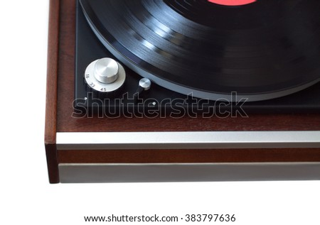 Part of vintage record player with wood finish with black LP vinyl record top view isolated on white horizontal photo from above closeup