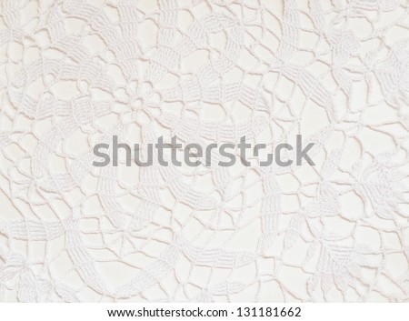 Part of white crochet tablecloth for background - stock photo