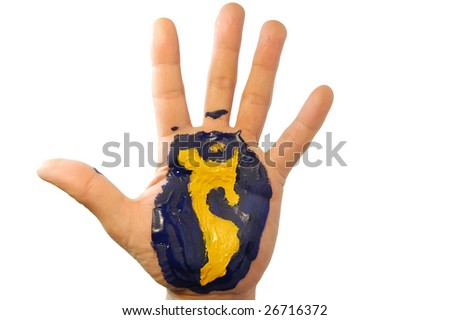 part of world in paint on hand - stock photo