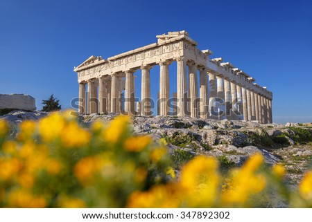 Parthenon temple with spring flowers on the  Acropolis in Athens, Greece - stock photo