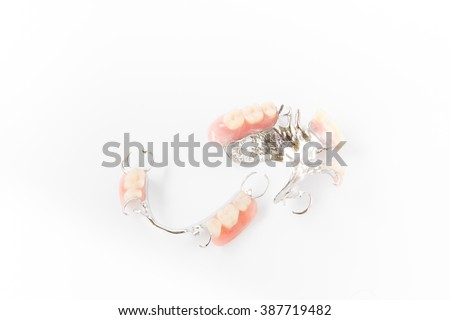 partial dental prosthetics(dentureX on a white background - stock photo